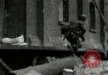 Image of U.S. Army patrol moves carefully through ruins of German City Ludwigshafen Germany, 1945, second 8 stock footage video 65675074328