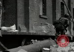 Image of U.S. Army patrol moves carefully through ruins of German City Ludwigshafen Germany, 1945, second 9 stock footage video 65675074328
