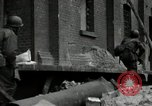 Image of U.S. Army patrol moves carefully through ruins of German City Ludwigshafen Germany, 1945, second 10 stock footage video 65675074328