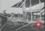 Image of Theodore Roosevelt flying with Wright pilot Archibald Hoxsey United States USA, 1910, second 1 stock footage video 65675074471