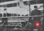 Image of Theodore Roosevelt flying with Wright pilot Archibald Hoxsey United States USA, 1910, second 3 stock footage video 65675074471