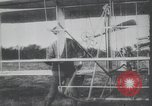Image of Theodore Roosevelt flying with Wright pilot Archibald Hoxsey United States USA, 1910, second 4 stock footage video 65675074471