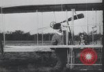 Image of Theodore Roosevelt flying with Wright pilot Archibald Hoxsey United States USA, 1910, second 6 stock footage video 65675074471