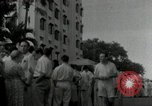 Image of people lined up Philippines, 1942, second 11 stock footage video 65675074518