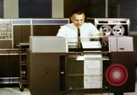 Image of User of early computers by American government workers United States USA, 1968, second 7 stock footage video 65675074553