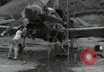 Image of USAAC mechanics perform maintenance on P-40 and P-400 airplanes Guadalcanal Solomon Islands, 1943, second 10 stock footage video 65675074690