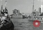 Image of tug boats moving the USS West Virginia after initial repairs in Pearl  Oahu Hawaii USA, 1942, second 1 stock footage video 65675074763