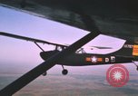 Image of O-1 Bird Dog aircraft Vietnam, 1962, second 6 stock footage video 65675075347