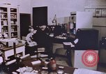 Image of crime laboratory analyst United States USA, 1969, second 4 stock footage video 65675075434