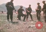 Image of Montagnard soldiers Pleiku South Vietnam, 1969, second 8 stock footage video 65675075555