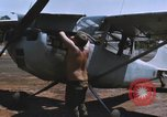 Image of O-1 Bird Dog liaison aircraft Bien Hoa Vietnam, 1970, second 9 stock footage video 65675075600