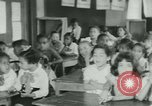 Image of Negro children New Orleans Louisiana USA, 1937, second 3 stock footage video 65675075660
