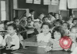 Image of Negro children New Orleans Louisiana USA, 1937, second 4 stock footage video 65675075660