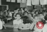 Image of Negro children New Orleans Louisiana USA, 1937, second 7 stock footage video 65675075660