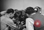 Image of technicians Florida United States USA, 1941, second 8 stock footage video 65675075676
