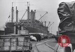 Image of Transport ships being loaded with troops and supplies for invasion task force United States USA, 1944, second 2 stock footage video 65675075793