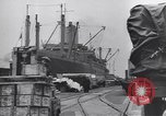 Image of Transport ships being loaded with troops and supplies for invasion task force United States USA, 1944, second 3 stock footage video 65675075793