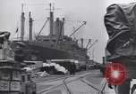 Image of Transport ships being loaded with troops and supplies for invasion task force United States USA, 1944, second 4 stock footage video 65675075793