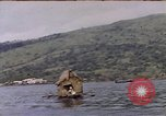 Image of outrigger canoe Pacific Ocean, 1945, second 5 stock footage video 65675075919
