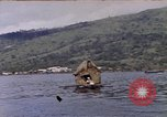Image of outrigger canoe Pacific Ocean, 1945, second 6 stock footage video 65675075919