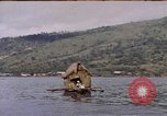 Image of outrigger canoe Pacific Ocean, 1945, second 10 stock footage video 65675075919