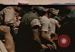 Image of Japanese prisoners leave captured submarines Pacific Theater, 1945, second 1 stock footage video 65675075961