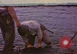 Image of US Sailors leave submarine and go ashore in life raft Japan, 1945, second 1 stock footage video 65675076035