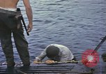 Image of US Sailors leave submarine and go ashore in life raft Japan, 1945, second 3 stock footage video 65675076035