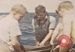 Image of Submarine, USS Cod, rescuing crew of Dutch submarine, O-19 Spratly Islands, 1945, second 5 stock footage video 65675076085