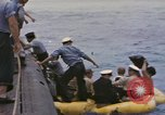 Image of USS Cod rescues crew of Dutch submarine in South China Sea Spratly Islands, 1945, second 4 stock footage video 65675076086
