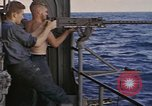 Image of USS Cod fires weapons to scuttle Dutch submarine, O-19 Spratly Islands, 1945, second 10 stock footage video 65675076088