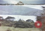 Image of US commandos set explosives on island Pacific Theater, 1944, second 1 stock footage video 65675076123