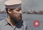 Image of US submarine crews and Japanese POWs disembarking Pearl Harbor Hawaii USA, 1944, second 2 stock footage video 65675076128