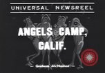 Image of frog jumping contest Angels Camp California USA, 1939, second 3 stock footage video 65675076143