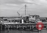 Image of torpedo at dock Montauk New York USA, 1944, second 10 stock footage video 65675076211