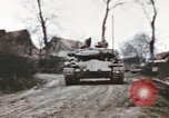 Image of U.S. armor and troops pass through town near end of World War II Germany, 1945, second 8 stock footage video 65675076290
