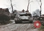 Image of U.S. armor and troops pass through town near end of World War II Germany, 1945, second 10 stock footage video 65675076290