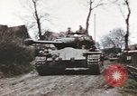 Image of U.S. armor and troops pass through town near end of World War II Germany, 1945, second 11 stock footage video 65675076290