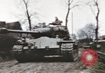 Image of U.S. armor and troops pass through town near end of World War II Germany, 1945, second 12 stock footage video 65675076290