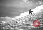 Image of skiing United States USA, 1941, second 8 stock footage video 65675076393