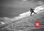 Image of skiing United States USA, 1941, second 10 stock footage video 65675076393