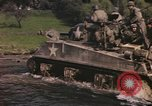 Image of U.S. troops ride on tanks crossing a stream Germany, 1945, second 6 stock footage video 65675076625