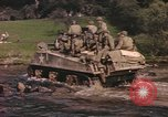 Image of U.S. troops ride on tanks crossing a stream Germany, 1945, second 9 stock footage video 65675076625
