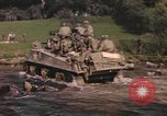 Image of U.S. troops ride on tanks crossing a stream Germany, 1945, second 10 stock footage video 65675076625