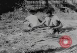 Image of bamboo containers Burma, 1943, second 11 stock footage video 65675076652