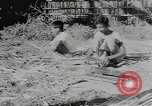Image of bamboo containers Burma, 1943, second 12 stock footage video 65675076652