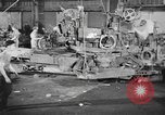 Image of Army artillery being repaired and reconditioned in a factory United States USA, 1945, second 6 stock footage video 65675076676