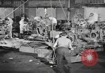 Image of Army artillery being repaired and reconditioned in a factory United States USA, 1945, second 8 stock footage video 65675076676