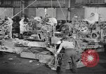 Image of Army artillery being repaired and reconditioned in a factory United States USA, 1945, second 9 stock footage video 65675076676