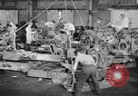 Image of Army artillery being repaired and reconditioned in a factory United States USA, 1945, second 10 stock footage video 65675076676